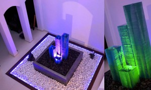 Glass column with light effects on a patio